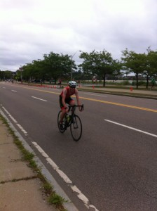 Cycling down the beach road at Boston Triathlon.