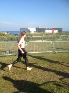 Stripping down my wetsuit and running in to T1 at Ironman 70.3 Edinburgh.