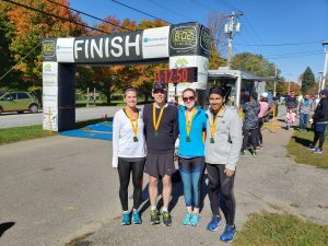 A very happy group of runners at the finish line of the GMAA half-marathon
